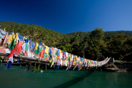 Bhutan rope bridge draped with prayer flags